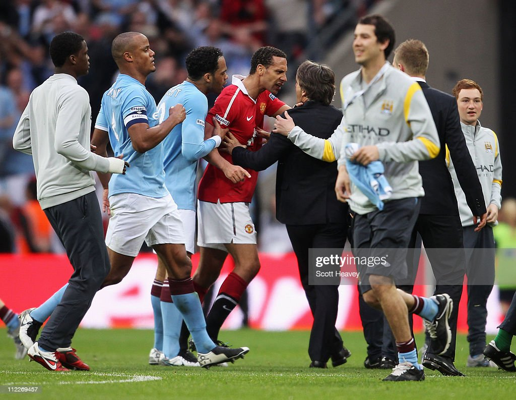 Rio Ferdinand of Man Utd clashes with Roberto Mancini, manager of Manchester City during the FA Cup sponsored by E.ON semi final match between Manchester City and Manchester United at Wembley Stadium on April 16, 2011 in London, England.