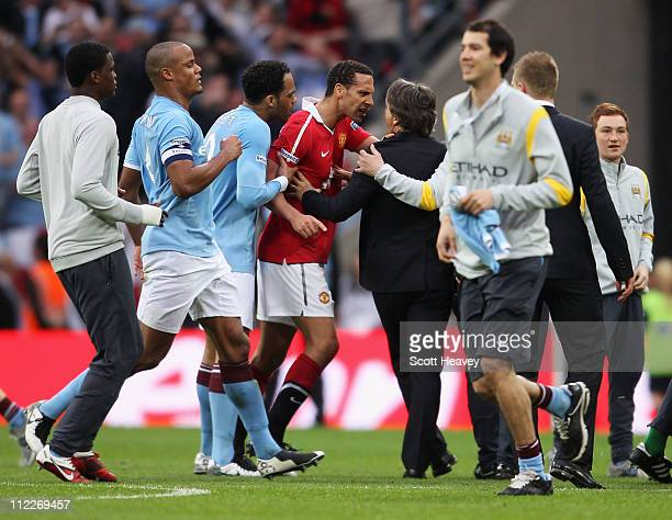 Rio Ferdinand of Man Utd clashes with Roberto Mancini manager of Manchester City during the FA Cup sponsored by EON semi final match between...
