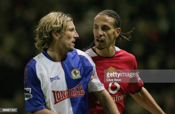 Rio Ferdinand of Manchester tussles with Blackburn's Robbie Savage during the Carling Cup Semi Final Second Leg between Manchester United and...