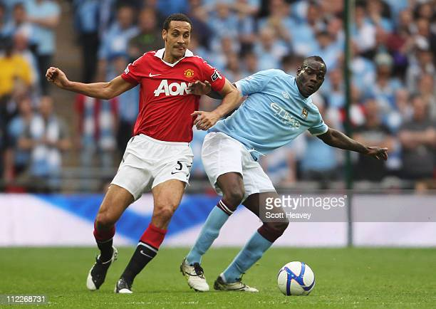 Rio Ferdinand of Manchester United and Mario Balotelli of Manchester City fight for the ball during the FA Cup sponsored by E.ON semi final match...