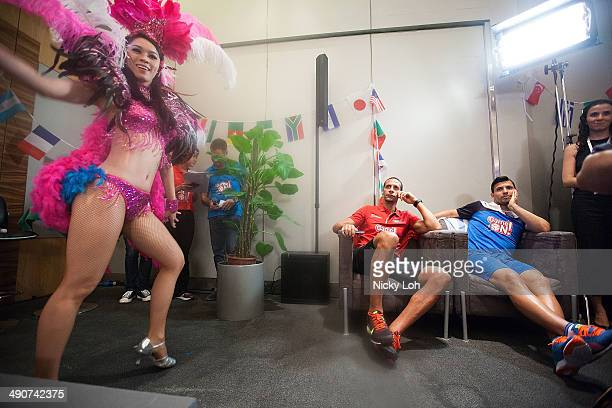 Rio Ferdinand of Manchester United and Sergio Aguero of Manchester City watch a samba performance during a press conference on May 15 2014 in...