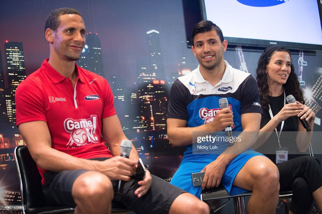 Rio Ferdinand (L) of Manchester United and Sergio Aguero (C) of Manchester City speak during a press conference on May 15, 2014 in Singapore.