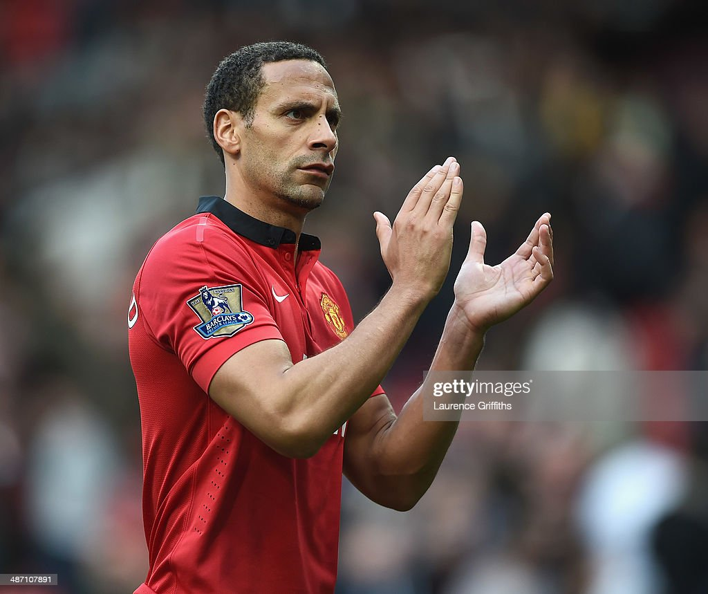 Rio Ferdinand of Manchester United applauds the fans after the Barclays Premier League match between Manchester United and Norwich City at Old Trafford on April 26, 2014 in Manchester, England.