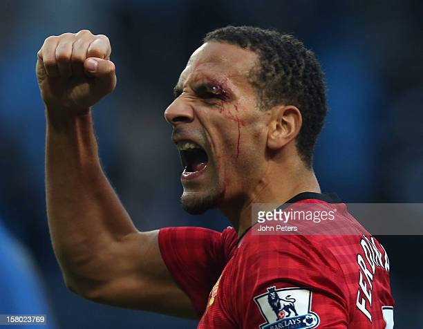 Rio Ferdinand of Manchester United celebrates at the end of the game after being hit by an object thrown from the crowd during the Barclays Premier...