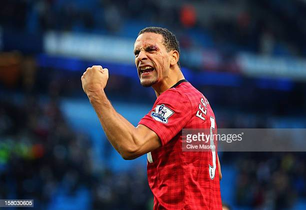 Rio Ferdinand of Manchester United celebrates at the end of the Barclays Premier League match between Manchester City and Manchester United at Etihad...