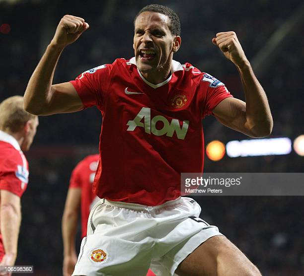 Rio Ferdinand of Manchester United celebrates JiSung Park scoring their second goal during the Barclays Premier League match between Manchester...
