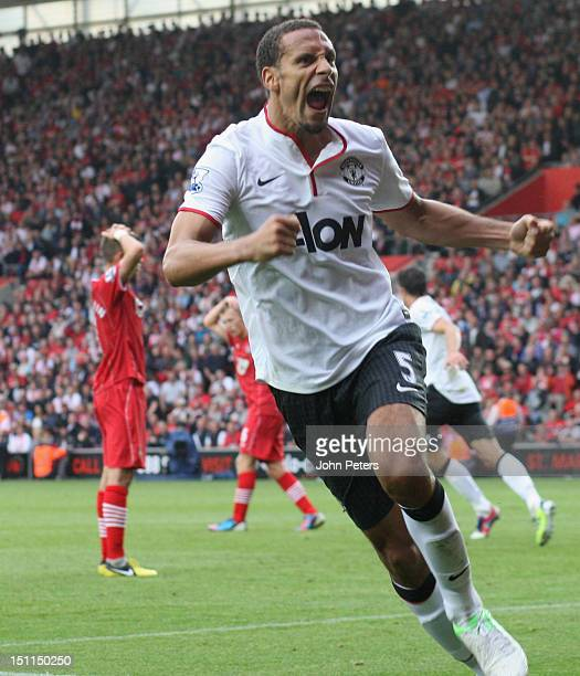 Rio Ferdinand of Manchester United celebrates Robin van Persie scoring their third goal during the Barclays Premier League match between Southampton...