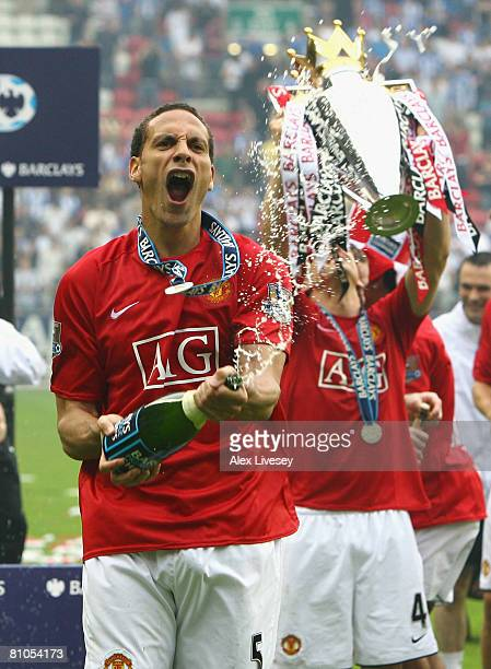 Rio Ferdinand of Manchester United celebrates with champagne after his team won the Barclays Premier League at the end of the Barclays Premier League...