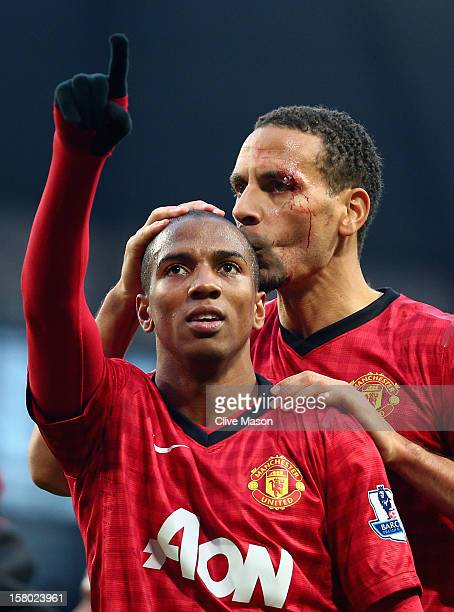 Rio Ferdinand of Manchester United celebrates with teammate Ashley Young at the end of the Barclays Premier League match between Manchester City and...