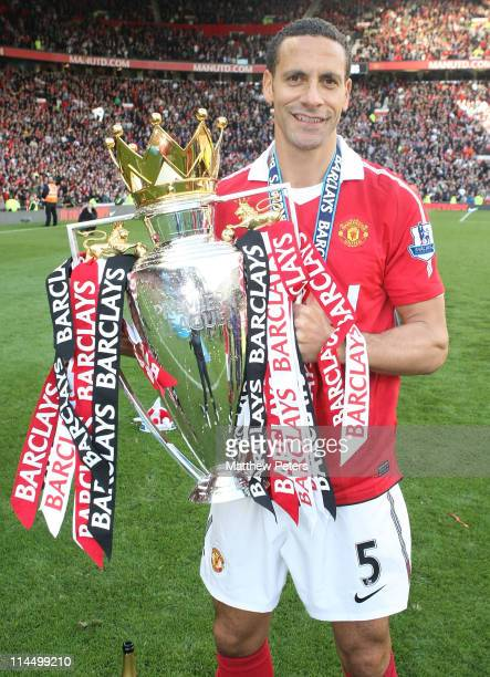Rio Ferdinand of Manchester United celebrates with the Barclays Premier League trophy after the Barclays Premier League match between Manchester...