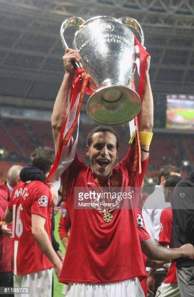Rio Ferdinand of Manchester United celebrates with the trophy after winning the UEFA Champions League Final match between Manchester United and...