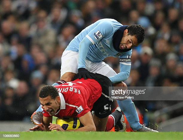 Rio Ferdinand of Manchester United clashes with Carlos Tevez of Manchester City during the Barclays Premier League match between Manchester City and...