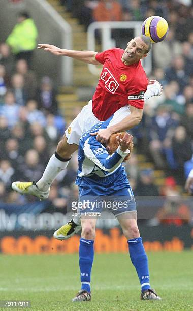 Rio Ferdinand of Manchester United clashes with Dave Kitson of Reading during the Barclays FA Premier League match between Reading and Manchester...