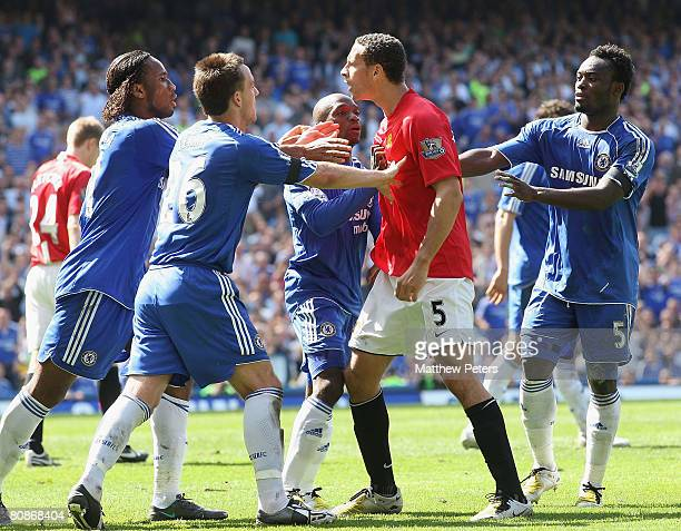 Rio Ferdinand of Manchester United clashes with John Terry Didier Drogba and Claude Makelele of Chelsea watch from the touchline during the Barclays...