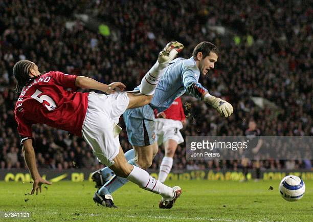 Rio Ferdinand of Manchester United clashes with Kelvin Davis of Sunderland during the Barclays Premiership match between Manchester United and...