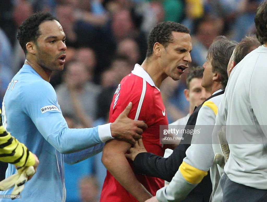 Rio Ferdinand of Manchester United clashes with Roberto Mancini of Manchester City after final whistle of the FA Cup sponsored by E.on Semi-Final match between Manchester United and Manchester City at Wembley Stadium on April 16, 2011 in London, England.