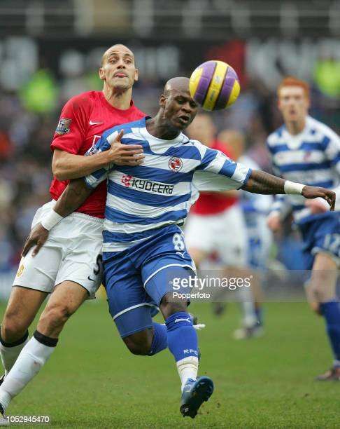 Rio Ferdinand of Manchester United competes with Leroy Lita of Reading during the Barclays Premier League match between Reading and Manchester United...