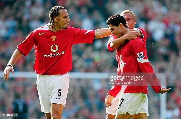 Rio Ferdinand of Manchester United congratulates goal scorer Cristiano Ronaldo on scoring the opening goal during the FA Barclays Premiership match...