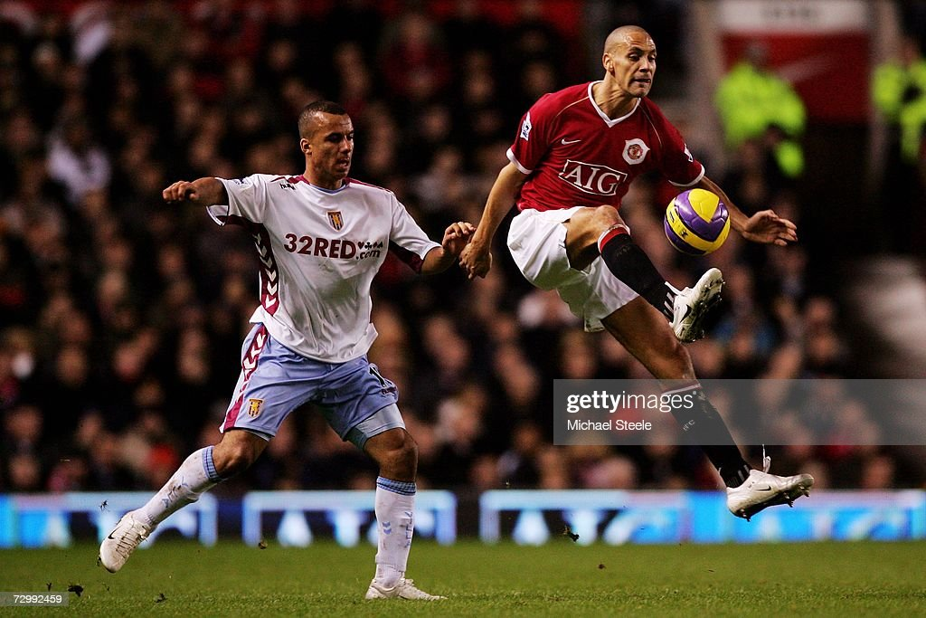 Rio Ferdinand of Manchester United controls the ball in front of Gabriel Agbonlahor of Aston Villa during the Barclays Premiership match between Manchester United and Aston Villa at Old Trafford on January 13, 2007 in Manchester, England.