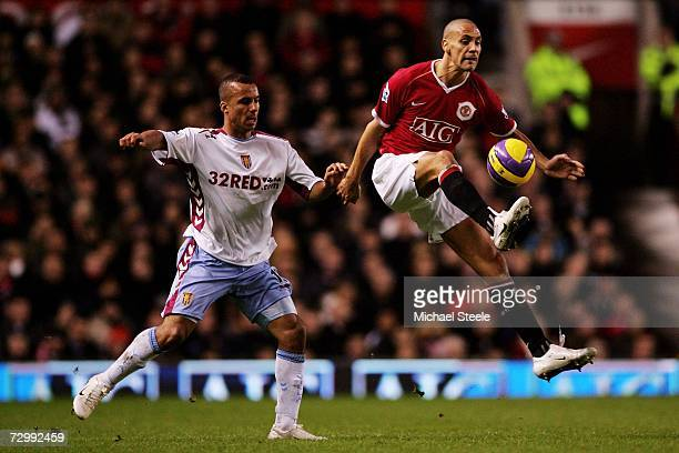 Rio Ferdinand of Manchester United controls the ball in front of Gabriel Agbonlahor of Aston Villa during the Barclays Premiership match between...
