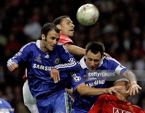 Rio Ferdinand of Manchester United fights for the ball with Ricardo Carvalho and John Terry of Chelsea during the Champions League Final match...