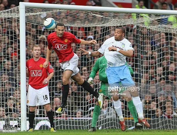 Rio Ferdinand of Manchester United heads the ball clear of goal during the Barclays FA Premier League match between Manchester United and Aston Villa...