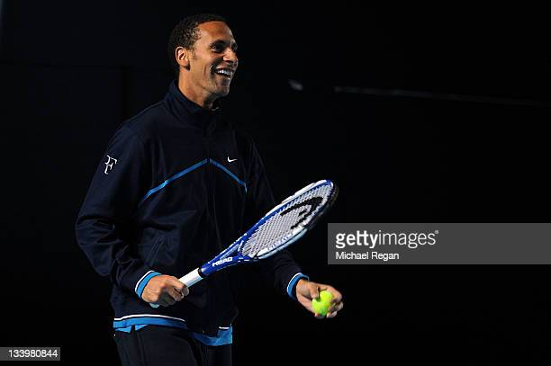 Rio Ferdinand of Manchester United hits the ball as he visits the practice courts during the Barclays ATP World Tour Finals at the O2 Arena on...