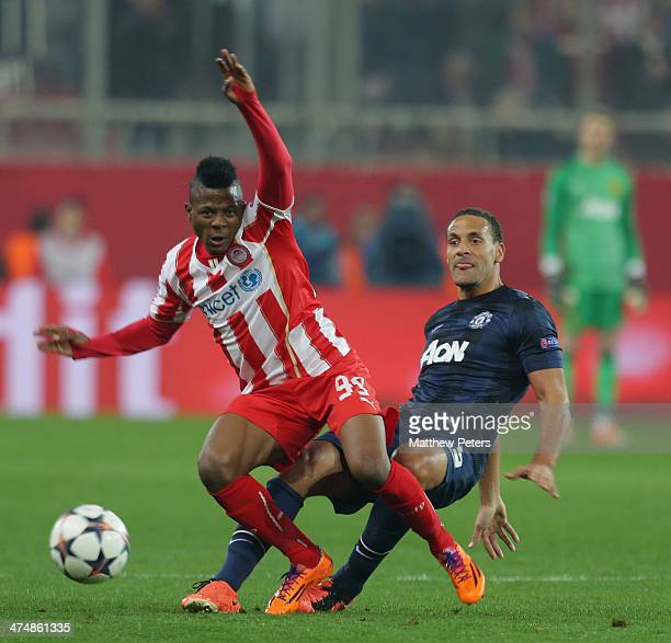 Rio Ferdinand of Manchester United in action with Michael Olaitan of Olympiacos FC during the UEFA Champions League Round of 16 match between...
