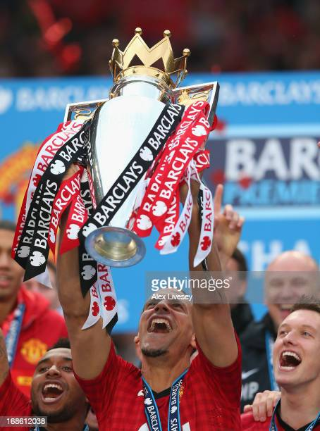 Rio Ferdinand of Manchester United lifts the Premier League trophy following the Barclays Premier League match between Manchester United and Swansea...