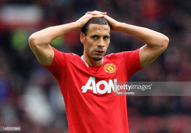 Rio Ferdinand of Manchester United looks dejected at the end of the Barclays Premier League match between Manchester United and Everton at Old...