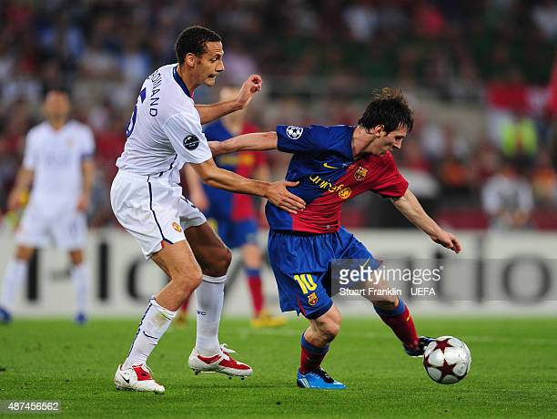 Rio Ferdinand of Manchester United marshalls Lionel Messi of Barcelona during the UEFA Champions League Final match between Barcelona and Manchester...