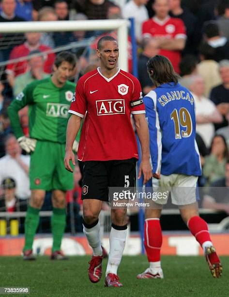 Rio Ferdinand of Manchester United reacts after he scores an own-goal during the Barclays Premiership match between Portsmouth and Manchester United...