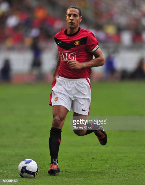 Rio Ferdinand of Manchester United runs with the ball during the pre-season friendly match between Manchester United and Malaysia XI at the Bukit...