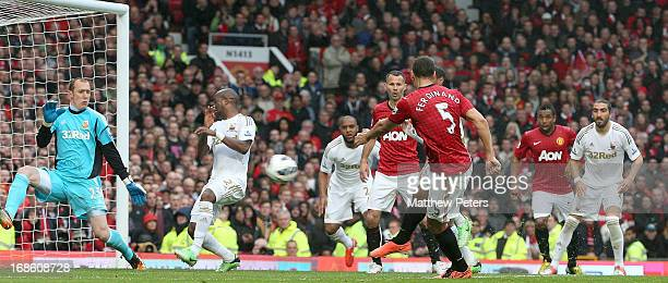 Rio Ferdinand of Manchester United scores their second goal during the Barclays Premier League match between Manchester United and Swansea City at...