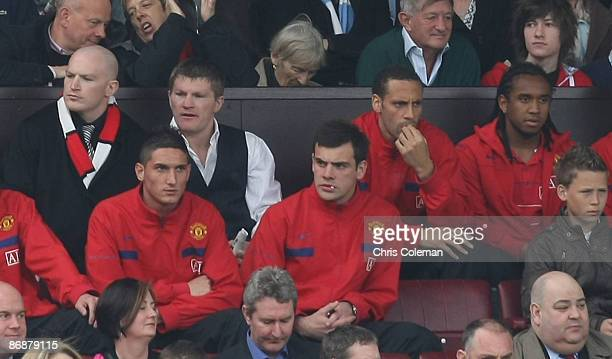 Rio Ferdinand of Manchester United sits in the directors' box with boxer Ricky Hatton during the Barclays Premier League match between Manchester...