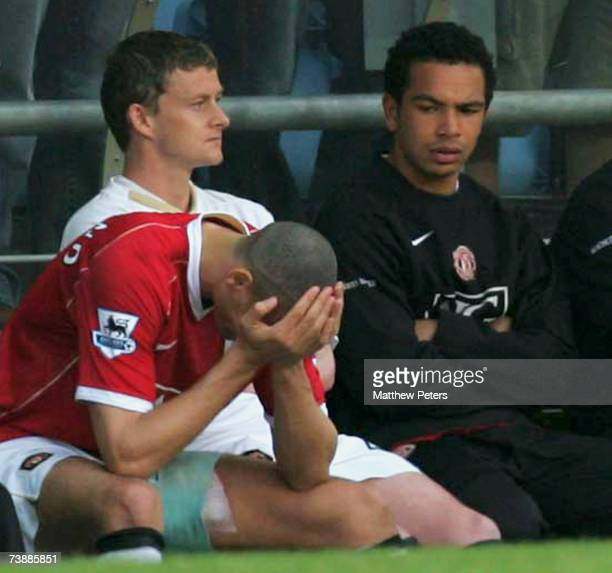 Rio Ferdinand of Manchester United sits on the bench after leaving the pitch with a groin injury during the FA Cup sponsored by E.ON Semi-final match...