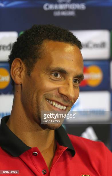 Rio Ferdinand of Manchester United speaks during a press conference ahead of their UEFA Champions League match against Bayer Leverkusen at Old...