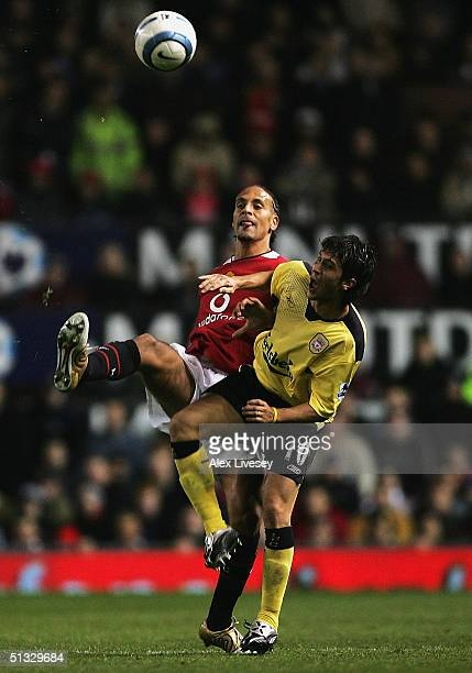 Rio Ferdinand of Manchester United tackles Luis Garcia of Liverpool during the Barclays Premiership match between Manchester United and Liverpool at...
