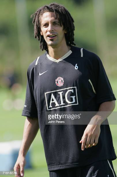 Rio Ferdinand of Manchester United takes a break during a first team training session at Carrington Training Ground on July 25 2006 in Manchester...