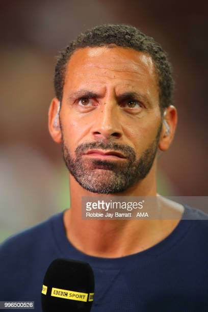 Rio Ferdinand performs pundit duties for the BBC at the end of the 2018 FIFA World Cup Russia Semi Final match between Croatia and England at...