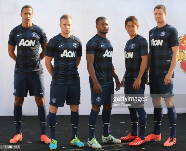 Rio Ferdinand Tom Cleverley Patrice Evra Shinji Kagawa and Jonny Evans of Manchester United pose in the new Manchester United away kit at the Nike...