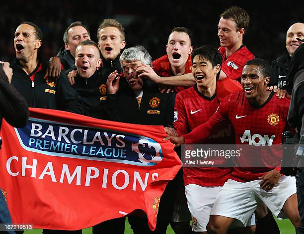 Rio Ferdinand Tom Cleverley Phil Jones Shinji Kagawa Jonny Evans and Antonio Valencia of Manchester United celebrate winning the Premier League title...