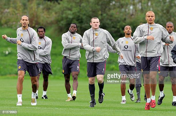 Rio Ferdinand, Wayne Rooney and Wes Brown in action during a first team training session at Carrington Training Ground on October 1, 2004 in...