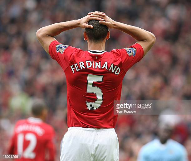Rio Ferdinandof Manchester United shows his disappointment during the Barclays Premier League match between Manchester United and Manchester City at...