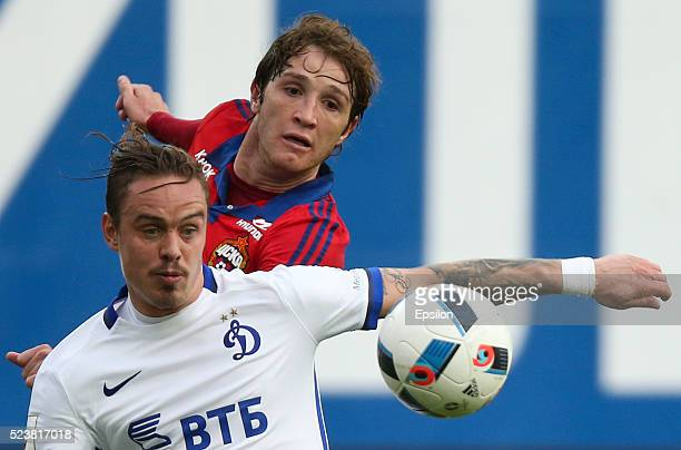 M��rio Fernandes of PFC CSKA Moscow challenged by Andrey Yeshchenko of FC Dinamo Moscow during the Russian Premier League match between PFC CSKA...