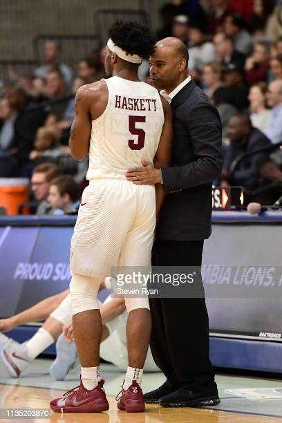 Rio Haskett speaks with head coach Tommy Amaker of the Harvard Crimson during a timeout against the Columbia Lions at Frances S. Levien Gymnasium on...