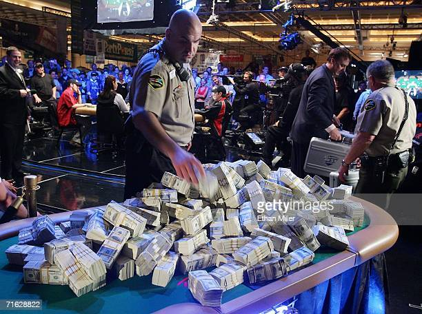 Rio Hotel Casino security officer Jeffrey Fiti helps stack USD 12 million near players competing at the final table of the World Series of Poker...