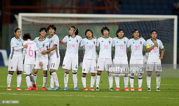 Rio Kanekatsu of Japan looks dejected as she joins her team mates after missing a penalty during the FIFA U17 Women's World Cup Jordan 2016 Final...