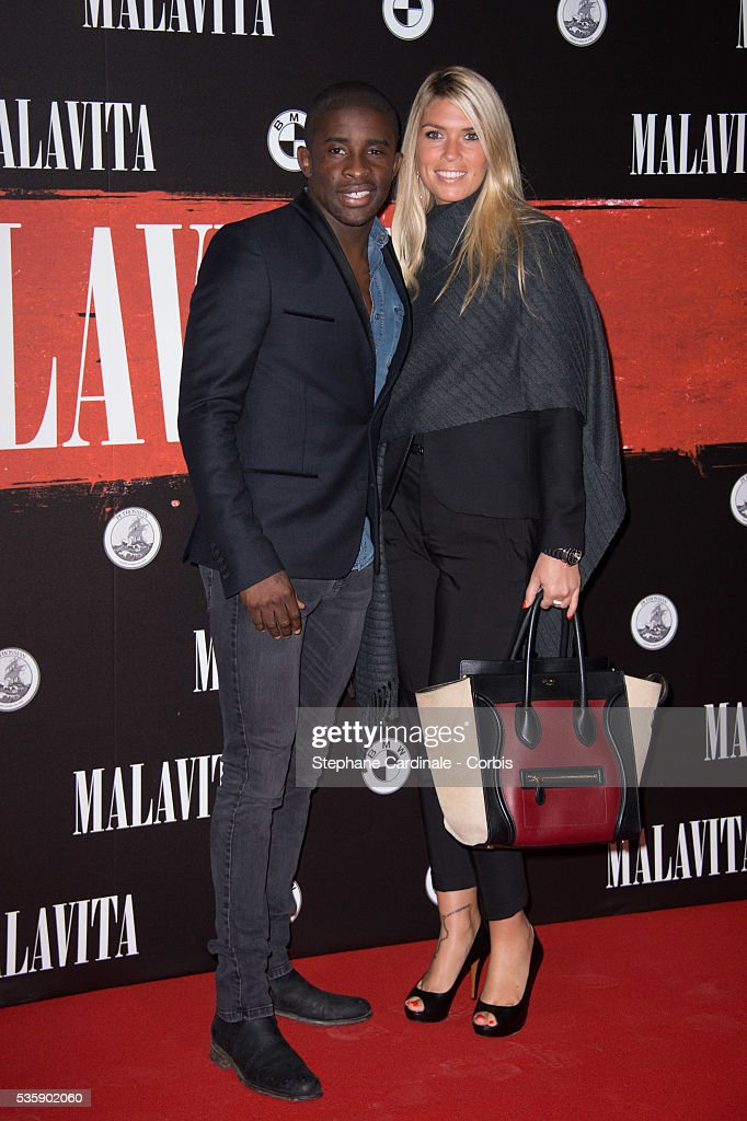 Rio Mavuba and guest attend the 'Malavita' premiere at Europacorp Cinemas at Aeroville Shopping Center, in Roissy-en-France, France.
