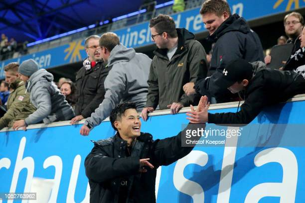 Rio Miyaichi of St Pauli celebrates wit the fans after winning 10 the Second Bundesliga match between MSV Duisburg and FC St Pauli at...